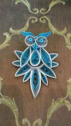 Paper quilled steampunk owl pin