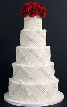 Multi-layered white wedding cake with fresh red roses on top #wedding #flowers #cake #weddingcake #roses