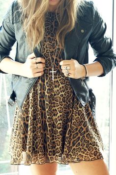 Leopard print dress teamed with a cool leather jacket and crucifix, the perfect edgy day time look...