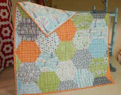 I've been pining for quilt made with the Backyard Baby fabrics.  Have found a store that offers the fabric kits.  Now who makes quilts?!  I must own this.