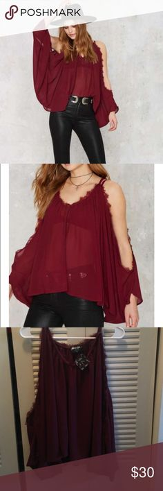 Nasty gal stunning cold shoulder top with lace Really beautiful brand new with tags nasty gal top! With cold shoulders and lace detail around neck and arms! In color burgundy Nasty Gal Tops
