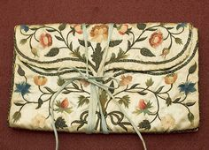 Folding silk pocket book with polychrome and metallic thread embroidery, dated c.1762, from the Vintage textile archives.