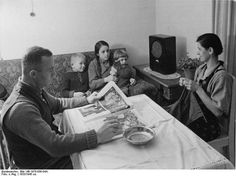 Family listens to radio-There were strict penalties for listening to foreign broadcasts during the war. Nevertheless, especially as the war wore on, many people risked imprisonment, and even sometimes death, to tune in to broadcasts from outside Germany. The BBC was especially popular.The Ministry of Public Enlightenment and Propaganda funded theatre performances and the making of films, which increased considerably their control over what was performed and screened.