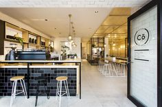 I like the effect with the dark tiles. Hutch & Co / Biasol: Design Studio