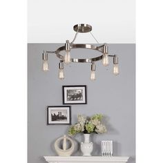 Give your home a vintage meets modern aesthetic with the Rae flush mount. Six Edison bulbs hang prominently from below the nickel finished circular frame.
