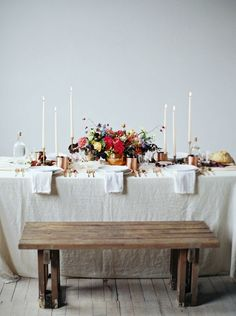 Rustic Tabletop. Wild Flowers and Long Candles