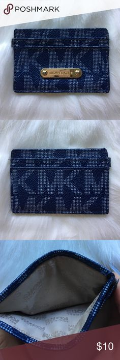Michael Kors Monogram Card Case Michael Kors Monogram Card Case, good condition, sight pull on the leather at side seam (pictured) Michael Kors Bags Wallets