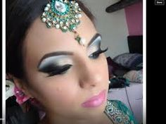 green dramatic eye makeup really stands out in 2015 trends