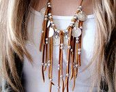 Leather Fringe Necklace Statement Necklace Coin Necklace Coin Charms Jewelry Afghan Kuchi Tribal Boho Native American Navajo Leather coin Necklace  Material: The final statement product handcrafted using a collection of silver plated pewter coin medallions decorated with leather fringe and silver plated beads. All accents are secured on top grade hand-selected deerskin lace. Adjustable  This listing includes a complimentary jewelry pouch to store and protect your purchase  SPARROW Jewels Are…