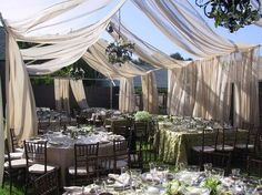 Back yard wedding. add some string christmas lights in the fabric for a elegant transition to evening.