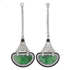 [Gorgeous] Pair of Art Deco Platinum, Diamond, Carved Jade, Black Onyx and Black Enamel Pendant-Earrings The slender bar links joined by pierced tapered panels, set with 6 old European-cut and rose-cut diamonds, accented by 2 sugarloaf cabochon black onyx, supporting 2 half moon-shaped carved jade panels approximately 10.0 x 17.6 x 1.2 mm., edged by black enamel, circa 1920. [Cross posted from Jewelry: Art Deco]