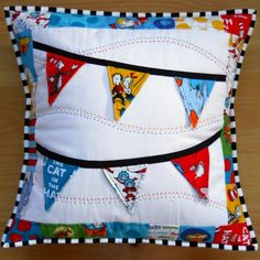 Dr. Seuss pennants quilting by NOVA -- there are little surprises under each flag!