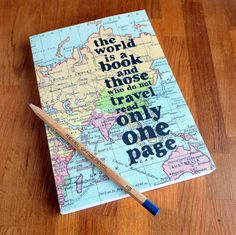 A beautiful travel journal covered in a vintage world map and a quote to inspire exploration.    ''The world is a book and those who do not travel