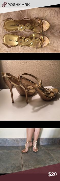 Gold T strap ankle strap heels with GEMS So beautiful. Too small,  I've worn them for NYE and special events inside. They have adjustable ankle straps. Size 6 true to size. Sturdy heel, the bottom is gold with beautiful pattern in the construction. Good quality bought from Arden B. Slight wear in toe bed area, not noticeable when worn, pictured. One gem is missing and it's NOT noticeable :) comfy shoes, besides the size :) Michael Antonio Shoes Heels