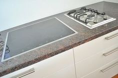 Combination of cooktops - induction and gas burners - offers flexibility and efficient use of kitchen benchtop space