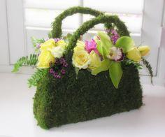 A flower girl's moss purse  by Fleur de Vie  is a good alternative to a basket.