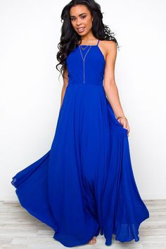 Hello beauty! The Aurora Maxi Dress in Royal is the perfect dress for all your summer celebrations! Featuring chiffon fabric that'll gracefully move with you, fully lined silhouette and adjustable straps that cross in the back. Hidden back zipper. Pair with your favorite heels and get to poppin the champagne!