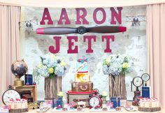 Amazing dessert table at a vintage airplanes first birthday party! See more party planning ideas at CatchMyParty.com!