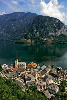 Austria - Hallstatt. Facts of Austria: Area: 83,855 sq km. Landlocked. The Alps in the south and west; flat plains along the Danube River in the east. Population: 8,387,491. Capital: Vienna. Official language: German. Languages: 20 languages.