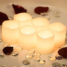 "Flameless Candles * Set of 6 Real Wax with 6 Extra Batteries Included FREE! Unscented and Ivory in Color * 2"" By 2"" Votive Style LED Flickering Lights * Great Gifts for any Occasion * Home Decor * Weddings * Romantic Settings"