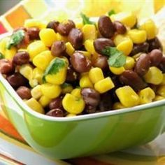 Corn and Black Bean Salad - Allrecipes.com | use fresh corn, prepared dry beans | add juice of 1 lime, chopped onion and 1 chopped tomato.