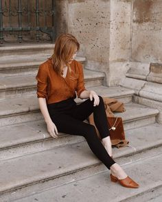 a gorgeous retro inspired look with black cropped skinnies, a rust colored shirt and matching mules plus a bag