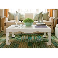 While decorating your old coffee table or buying a new one, you should select a style which fits your requirements. Adding flowers or even herbs can provide a beautiful and colorful focal point to the space, using natural elements will give your table interest and flow. Trays are also great to make the scale of the surface a little smaller so your coffee table doesn't seem like a plain piece of furniture. These decorating tips varying from natural elements to using the tray will create