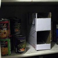 instructions to build your own can storage container from an old cardboard box. this is one step-up from my first engineering attempt. great for organizing the pantry!