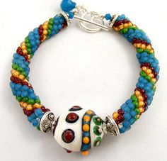 The colors used in this bracelet are really eye catching and I like how they make the bracelet unique by adding a bead in the middle