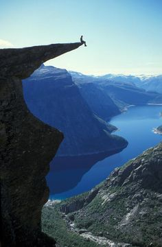 Trolltunga, Hardangerfjord, Norway.   10 hours hike - but you get a nice picture of yourself to hang on your living room wall. Fjord Norway, near the city of Bergen (BGO). Photo by Harald Hognerud.