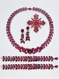 Antique Garnet and 10K Gold Parure (5), circa 19th Century. Including a necklace, length 16 ins; a pendant brooch, a pair of ear pendants, and two bracelets. 10k gold.