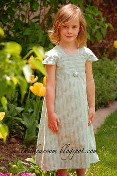 lovely girl's dress from a man's shirt.  I love how she used the direction of the stripes as a contrast on the bodice!