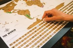 Scratch off Map - World Traveler Tracker Poster by Landmass Goods with flags of the world on the map. Scratch where you've been and plan your next trip!