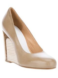 Beige leather pump from Maison Martin Margiela featuring a round toe, a contrasting nude stack wooden wedge with a stiletto cut detail and a leather sole.