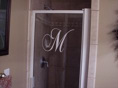 Vinyl monogram for shower door...maybe I wouldn't detest those glass shower doors so much with one of these on them! Maybe even etch them?