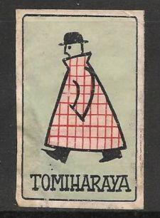 Matchbox Label Japan. Man and coat.