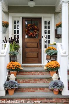 I love this welcoming fall porch - such great details including the vintage finds and HomeGoods cement garden finials eclecticallyvintage.com sponsored pin