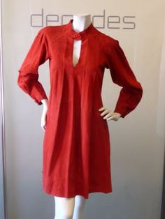 Early 70s Jean Muir suede key hole A-line dress with signature raised seams and a full sleeve that narrows femininely at the wrist. The key hole closes with one of Muir distinctively shaped Bakelite-esque buttons.