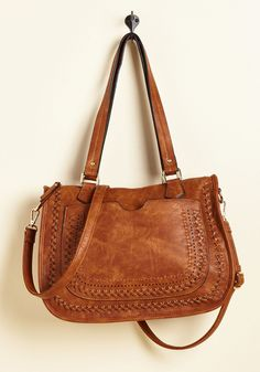 Adventure on the Agenda Bag in Caramel | Mod Retro Vintage Bags | ModCloth.com Take this tan purse along for the morning commute, or have it accompany you to a late-night flick with your friends - its faux-leather fabric punctuated with crisscross stitching, handy front pouch, and convenient shoulder strap make it a viable candidate for wherever the itinerary takes you!