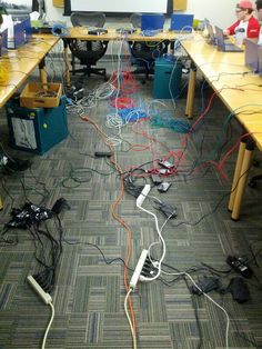 An example of much needed cable management! We have everything you need to clean up these messes: http://www.cabletiesandmore.com/