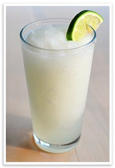 Frozen Coconut Limeade: 5 1/2 cups ice, 5/8 cup coconut rum (for non-alcoholic version, substitute cream of coconut), 4-5 tablespoons frozen limeade concentrate (substitute lemonade version if you'd like), and 1/8 cup water.