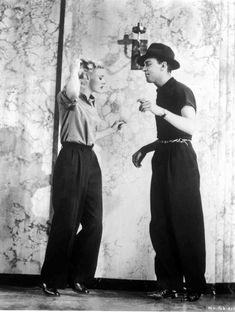 Ginger Rogers and dance director Hermes Pan, rehearsing routine for Swing Time (1936)