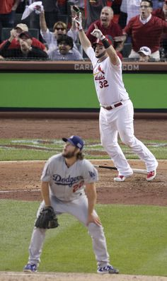 St. Louis Cardinals first baseman Matt Adams (32) reacts in front of Los Angeles Dodgers starting pitcher Clayton Kershaw after hitting a three-run home run in the seventh inning of Game 4 of baseball's NL Division Series Tuesday, Oct. 7, 2014, in St. Louis. (AP Photo/Tom Gannam)