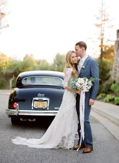 Love her bouquet and his suit color. The car on the background tho...  | mysweetengagement.com