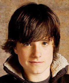 Photo of Josh Hutcherson medium length shaggy hairstyle.