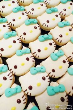 hello kitty macarons with a turquoise bow