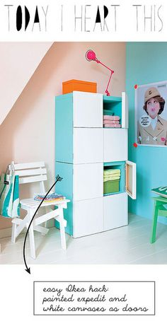 IKEA hack - expedit with canvas doors - This would be cool with a painting painted on the canvas!