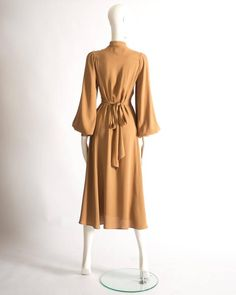 View this item and discover similar for sale at - Ossie Clark mandarin collared dress constructed in caramel moss crepe. Button closures, pleated bishop sleeves, attached belt fastening at the rear, and Elegant Dresses, Vintage Dresses, Beautiful Dresses, Casual Dresses, Vintage Outfits, Ossie Clark, 1950s Fashion, Vintage Fashion, Hijab Fashion
