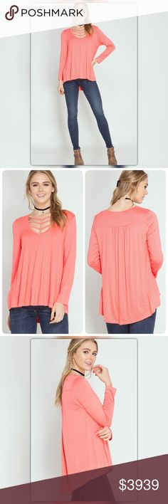 Coral Long Sleeve Strap Detail Top Chic and effortless! This coral, long sleeve swing top has trendy strap details at the neckline. The asymmetrical design makes it a perfect pair with skinny jeans and booties. It is made of 70% cotton and 30% rayon. The NEW Boutique Tops