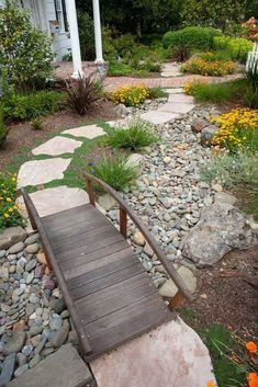 31 Amazing Dry River Bed Landscaping Ideas You Will Love - a nest with a yard Interested in renovating your garden? Nothing is more stunning than these dry river bed landscaping ideas. Cheap Landscaping Ideas, Low Water Landscaping, Landscaping With Rocks, Front Yard Landscaping, Walkway Ideas, Dry Riverbed Landscaping, Outdoor Landscaping, Front Yard Decor, Rock Garden Design